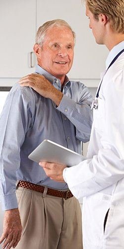 NC Surgery Lifestyle Image Doctor examining patient shoulder and arm