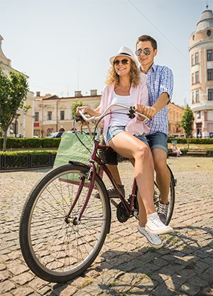 NC Surgery Lifestyle Image Couple on Bike Legs Showing
