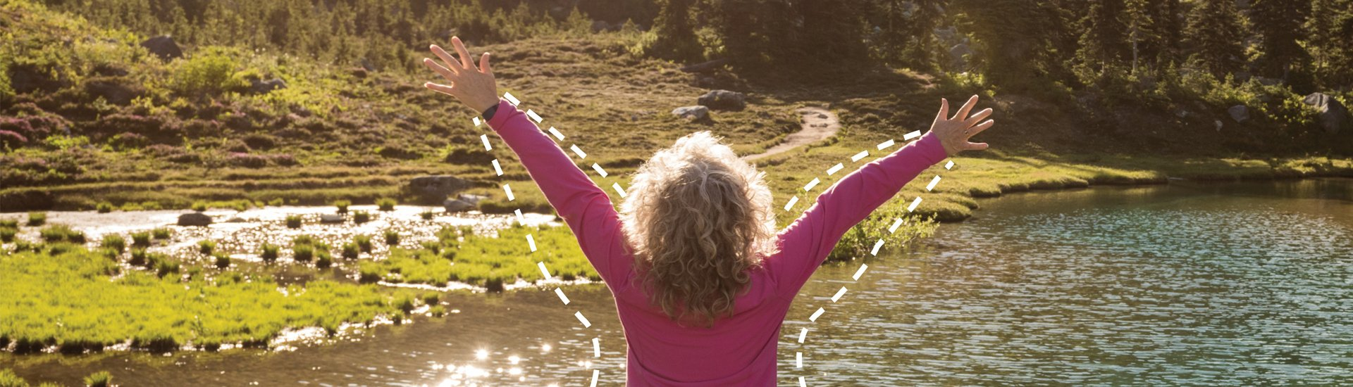 Woman stretching out arms at beautiful lake